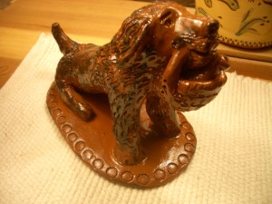 redware dog with basket