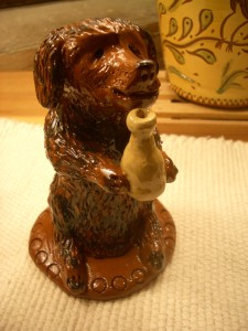 redware standing dog with bottle